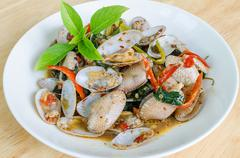 Fried clams in roasted chili paste Stock Photos