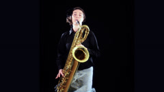 A woman playing the baritone sax Stock Footage