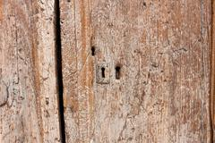 Old wooden and grungy locked door Stock Photos
