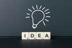 Idea word and light bulb Stock Photos
