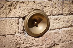 Antique bell calling porter, italy Stock Photos