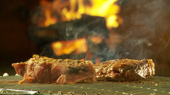 Sirloin steaks on barbecue grid Stock Footage
