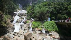 Mountain waterfall near the road, frequented attended by tourists. sri lanka Stock Footage