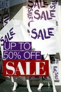 The word sale on paper bags in shopping window Stock Photos