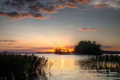 Sundown on horizon Stock Photos