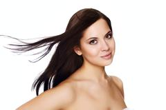 Portrait of a beautiful young woman with hair flying Stock Photos