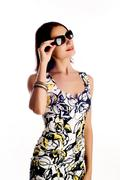 young woman wearing the big modern sunglasses. studio shot on a white backgro - stock photo