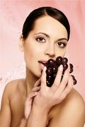 beautiful young woman with grape - stock photo
