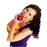 Young beautiful girl with fruit Stock Photos