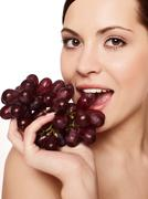 Beautiful young woman with grape Stock Photos