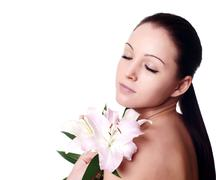 portrait of fresh and beautiful woman with flower isolated - stock photo
