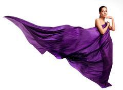 beautiful young woman in purple long dress - stock photo