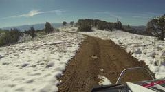 Driving RZR ATV 4x4 mountain road snow sun flare POV HD 0073 Stock Footage