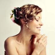 Beauty woman portrait, hairstyle with flowers Stock Photos