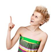 young beautiful female with short hair executive pointing at copyspace - stock photo