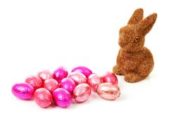 easter bunny and pink eggs - stock photo