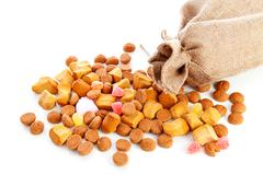 bag with typical dutch sweets: pepernoten (ginger nuts) - stock photo