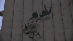 Street art by famous Banksy Stock Footage