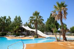 swimming pool with slides - stock photo