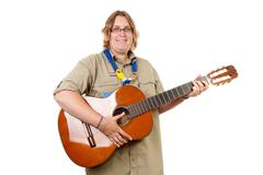 dutch female scout with guitar - stock photo