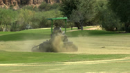 Stock Video Footage of Tractor Mows Golf Course Greens