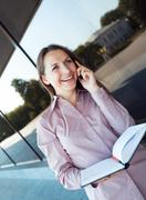 Businesswoman with cellphone and organizer Stock Photos
