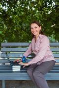 Businesswoman with computer laptop Stock Photos