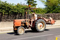 man is driving his tractor - stock photo