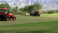 Stock Video Footage of Multiple Tractors Maintain Golf Course ED