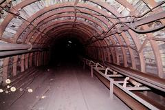 Tunnel to the dark from a coal mine Stock Photos