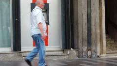 ATM cash machine, people walking. - stock footage