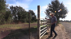 Cowboy , Sheriff ,steel gate Stock Footage
