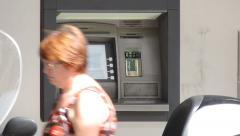 ATM cash mashine, walking people. - stock footage