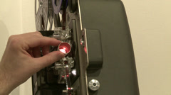 8mm film projector adjusting focus Stock Footage