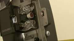 8mm film projector play, tilt up reveal reels, medium shot Stock Footage