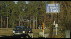 Virginia Beach welcome sign traffic - stock footage