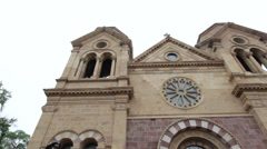 Cathedral Bascilica of Saint Francis of Assisi exterior pan Stock Footage