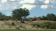 Stock Video Footage of Time Lapse Tractors Golf Course