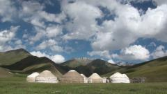 Clouds 'fly' over traditional nomadic yurt camp in Central Asia Stock Footage