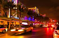 Stock Photo of Ocean Drive scene at night lights, Miami beach, Florida.