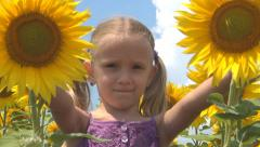 Child, Girl Playing with Sunflower in Agriculture Field, Children at Countryside - stock footage