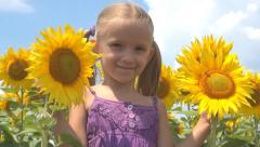 Girl, Child Playing with Sunflower in Agriculture Field, Children at Countryside - stock footage