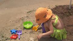 Child, Little Girl Playing with Toys in Sand on Beach, Seashore, Sea, Children Stock Footage