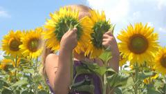 Child, Girl Playing Hide and Seek in Sunflower Field, Children at Countryside - stock footage