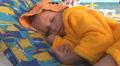 Child, Little Girl Sleeping on Beach, Sleepy Kid on Seashore, Children Lifestyle HD Footage
