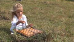 Child, Girl Playing, Practice Counting, Numbering on a Chessboard on Meadow Stock Footage