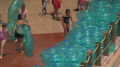 Water Park Visitors Collecting Tubes for Waterslide Stock Footage