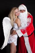 santa claus man and woman angel - stock photo