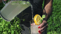 Woman pouring water into the glass, slow motion shot at 480fps Stock Footage