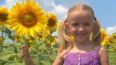 Laughing Little Girl, Child Playing in Sunflower Field, Children at Countryside - stock footage